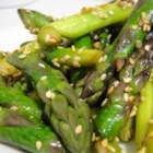 Awesomely Easy Sesame Asparagus - Asparagus is steamed and then tossed with olive oil, kosher salt and toasted sesame seeds.