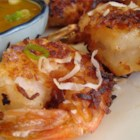 Twice-Cooked Coconut Shrimp - Shrimp that are dipped in a scrumptious batter, rolled in coconut, fried, then baked. The dipping sauce is the clincher: marmalade, honey, hot sauce and mustard!