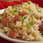 Island-Style Fried Rice - Fried rice, Hawaiian-style, features such beloved island delicacies as pineapple, Chinese lup cheong sausage, and that famous luncheon meat in the rounded-off cans.