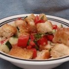 Panzanella - Toasted bread and colorful fresh veggies are tossed with a light dressing in this Italian salad.  Of course, you can add or take away ingredients to your liking!