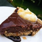 Chocolate Peanut Butter Pie V - Milk is thickened and sweetened in the microwave and then peanut butter, chocolate chips, and marshmallow cream are stirred in. Everything melts and mingles and is poured into a graham cracker crust. Chill before serving.