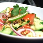 Thai Cucumber Tomato  Salad - Give that summer salad a twist of Thai flavor with cucumbers, tomatoes, lime juice, cilantro, and chopped peanuts.