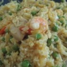 Curry Pineapple Fried Rice - Thailand is the inspiration for this quick, stir-fried dish of rice, curry, chicken meat, and pineapple.