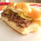 Original Homemade Italian Beef - Chuck roast is slow-cooked with Italian salad dressing mix and pickled peppers until it is tender enough to shred with a fork.