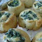 Spinach Pinwheels - Packaged crescent dough makes task of rolling these spinach and herb-cheese-filled rounds particularly easy; they're best fresh from the oven.