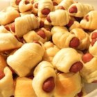 Pigs in a Blanket - Hot dogs, wrapped in melted cheese and tucked into browned biscuits