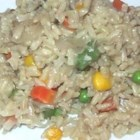 Indian Vegetable Rice - Basmati rice enhanced with the flavors of jeera (cumin), garam masala, mixed vegetables and onions.