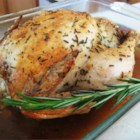 Roast Chicken with Rosemary - Stuff the cavity of a whole roasting chicken with onion and fresh rosemary for a simple and delicious baked chicken, just like the ones in Italian markets.