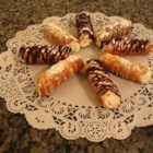 Cannoli II - These are an Italian cookie with the traditional ricotta cheese filling. You will need a pizzelle iron and cooking cylinders to form the cookies.