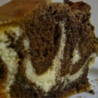 Marble Swirl Pound Cake - A tube cake with vanilla and chocolate layers swirled together to achieve a marbled effect.