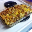 Johnny Marzetti V - Egg noodles are layered in a casserole with two cheeses and a tasty meat and veggie mixture. Serve with a nice Caesar salad and some garlic bread for a wonderful family treat.