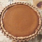 Pilgrim Pumpkin Pie - The made-from-scratch pie dough rolls out easily, offering a perfect 9-inch pie crust for the delicious pumpkin filling. That filling is sweetened with honey, spiced with cinnamon, ginger, and cloves, and made nice and creamy with evaporated milk. Serve with a spoonful of honey-ginger whipped cream.