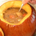Pumpkin Stew - This is a marvelous autumn potluck dinner. Everyone will be very impressed with this thick beef stew made and served in a pumpkin shell! Use a 10 to 12 pound pumpkin; be sure not to overbake!