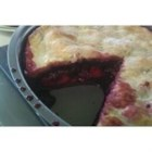 Grandma's Blackberry Pie - Slices of apple soak up the juices from the blackberries as this simple pie bakes in the oven.