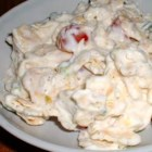 Georgia Cracker Salad - Crackers are tossed with tomato, egg and green onion in the quick mayonnaise salad. This is a traditional Southern salad. Best if eaten immediately upon preparing.