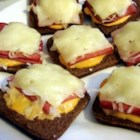 Mini Reubens - Mini Reuben Sandwiches are quickly made on cocktail rye and broiled for an open-faced hot appetizer that is sure to please!