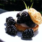 Blackberry Puff Pastry Tarts - Prepared puff pastry shells filled with sweetened cream cheese and blackberries are baked in minutes to make a fast and easy dessert.