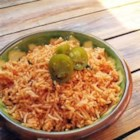 Mexican Rice Pilaf - A nice vegetable broth and tomato sauce give this rice pilaf a hearty flavor. Cumin, chili powder and jalapeno give it bite. And the chopped tomatoes and shredded cheese swirled in at the last minute, finish it perfectly.