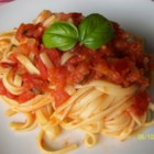 Fresh Tomato Basil Sauce - Tomatoes, basil, onion and garlic simmer for two hours for an authentic home-cooked flavor.