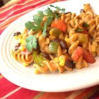 Southwestern Pasta Salad - Pasta is tossed with a zesty dressing of lime juice, chili powder and cumin. Corn, black beans, red and green bell pepper, tomatoes and cilantro add texture, flavor and color.