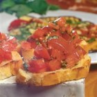 Fantastic Fennel Bruschetta - French bread slices, brushed with olive oil and toasted until golden brown, get a flavorful topping of fresh tomato, basil, and fennel seeds for a perfect summer appetizer or light lunch.