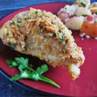 My Mom's Parmesan Chicken - Parmesan-crusted chicken bathes in butter and white wine for an elegant touch to a family favorite.