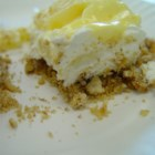 Pineapple Pretzel Salad - A pretzel crust topped with sweetened cream cheese, pineapple, pudding and whipped topping.