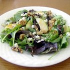 Tangy Pear and Blue Cheese Salad - Romaine, blue cheese, chopped pears, walnuts, and red onion, combined with a tangy dressing, make this salad unforgettable. It is a sure hit worth trying!