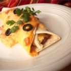 Mild Cheesy Chicken Enchiladas - Sour cream and Cheddar set a smooth tone for these basic enchiladas baked with tomatoes.