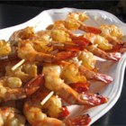 Honey Grilled Shrimp - Easy and delicious! Onions, peppers, and mushrooms are perfect when alternated with shrimp on the skewers. Just cut into bite-sized pieces and add them to the marinade with the shrimp. Serve with rice and a salad.