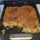 Kugel - Egg noodles are baked with a creamy mixture of eggs, cream cheese, sour cream and cottage cheese.  Graham cracker crumbs, sugar and melted butter top it all off.