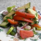 Cucumber, Tomato and Red Onion Salad with Mint - This refreshing, light summer salad features fresh cucumbers, tomatoes and red onions with a sweet and sour mint dressing.