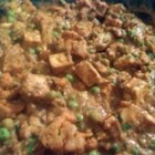 Cauliflower and Tofu Masala - Pressed tofu cubes are baked with a yogurt and spice sauce, then simmered with cauliflower and peas in a creamy red sauce.