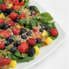 Mango Berry Fruit Salad - Several types of berries, toasted nuts, and a mango dressing are lovely and delicious with mixed greens.