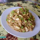 Peanut Butter Noodles - Smooth peanut butter, sweet honey, salty soy sauce, and fiery fresh ginger simmer with chicken broth to make a delectable sauce for boiled udon noodles.