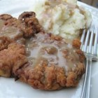 The Best Chicken Fried Steak - This recipe for chicken fried steak includes a batter spiked with Tabasco Sauce and a pan gravy that is sure to satisfy all the chicken fried steak lovers at your table.