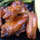 Detroit Hot Honey Wings - These Detroit style wings are honey glazed as they grill and tossed with a sweet and spicy sauce right off the heat. Challenge your friends with more cayenne and hot sauce, or pull back the heat and serve with a blue cheese dressing to calm the fire!