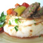 Slow Cooker Swiss Steak - Browned round steak is tossed in a slow cooker with vegetables, seasonings, and tomato juice and cooked until the meat is tender.