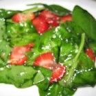 Spinach and Strawberry Salad - This salad has lots of spinach, lots of fresh, sliced strawberries, and a delicious, sweetened oil and vinegar dressing spiked with poppy and sesame seeds.