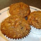 Carrot Oatmeal Muffins - A rich, moist muffin packed with whole wheat, oatmeal, raisins, carrots, pineapple, coconut, and a cream cheese surprise baked right in the center! Great for breakfast and kids love them! I vary the recipe depending what I have on hand and it always works out great. Hope you enjoy!