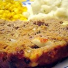 Incredibly Cheesy Turkey Meatloaf - This incredible meatloaf is sure to be a family favorite. It's SIMPLE to make using turkey, loads of cheese, and Italian bread crumbs.