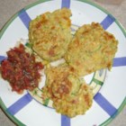 Zucchini Corn Fritters - Light and fluffy with lots of zucchini and fresh corn, these yummy fritters are a family favorite. Serve hot with ranch dressing.