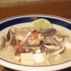 Thai Red Curry Tofu Soup - This is a Thai-inspired soup with tofu, mushrooms, coconut milk, and rice noodles.