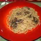 Linguine with Clam Sauce and Baby Portobello Mushrooms - What makes this clam sauce so flavorful is the chicken bouillon, Worcestershire sauce, and baby portobello mushrooms. The delicious sauce is finished with herbs and butter.