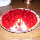 Cherry Cream Cheese Pie - This pie is heavy on flavor but light on calories. Light cherry pie filling and fat-free condensed milk are used to create this very creamy cheesecake crowned with cherries.