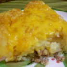 Tater Tot Casserole I - A simple but satisfying breakfast casserole featuring sausage, cheese and petite potato croquettes.
