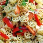 Caribbean Crabmeat Salad - Tender rotini pasta is tossed with imitation crabmeat, red pepper strips, chunks of mango, minced jalapeno and fresh cilantro and drizzled with a tangy lime vinaigrette.