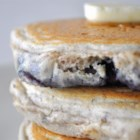 Blueberry Flax Pancakes - Fluffy pancakes with ground flax seed and blueberries for a healthier, fiber filled pancake.