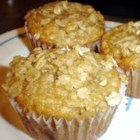 Banana Oat Muffins - These chewy muffins are packed with oats and garnished with a sweet and crunchy topping.