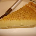 Egg Custard Pie III - This very old recipe has a small amount of milk and a bit of flour stirred into the custard, so it bakes up more dense than a traditional custard. And the nutmeg adds a wonderful flavor to this heavier baked pie. Serve warm or cold with whipped cream.